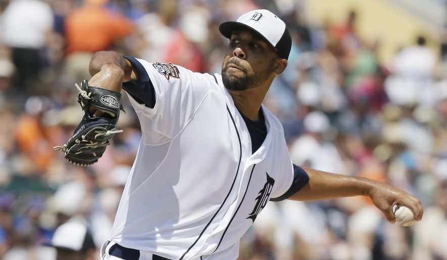 FILE- In this March 21, 2015, file photo, Detroit Tigers starting pitcher David Price throws during the first inning of a spring training exhibition baseball game against the New York Mets in Lakeland, Fla. Tigers will start the season Monday, April 6, with Price as the opening-day pitcher. For the first time since 2007, Justin Verlander won't be the opening-day starter. (AP Photo/Carlos Osorio, File)