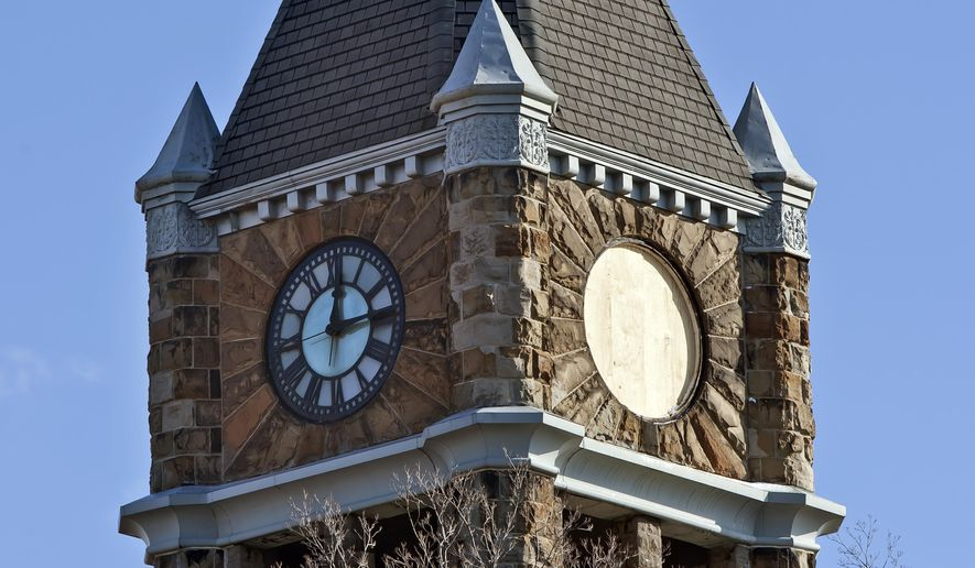 This Dec. 3, 2014, photo shows the Hackley Administration Building clock tower in Muskegon, Mich. The clock was being repaired after being damaged in a storm. The building dates to the 1890s and the clock was an original part of the building. (AP Photo/The Muskegon Chronicle, Cory Morse) ALL LOCAL TELEVISION OUT; LOCAL TELEVISION INTERNET OUT