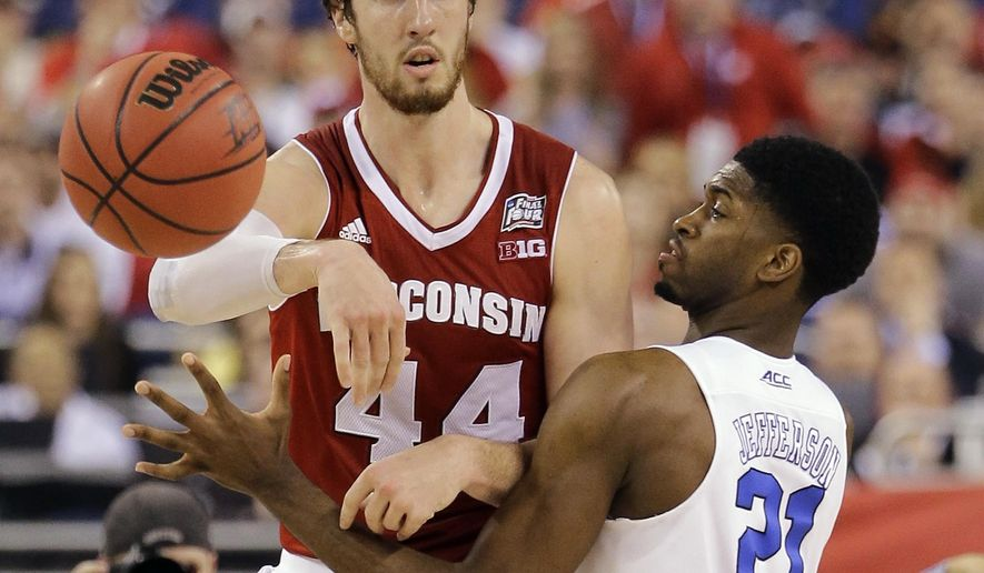 Wisconsin's Frank Kaminsky (44) passes against Duke's Amile Jefferson (21) during the second half of the NCAA Final Four college basketball tournament championship game Monday, April 6, 2015, in Indianapolis. (AP Photo/David J. Phillip)