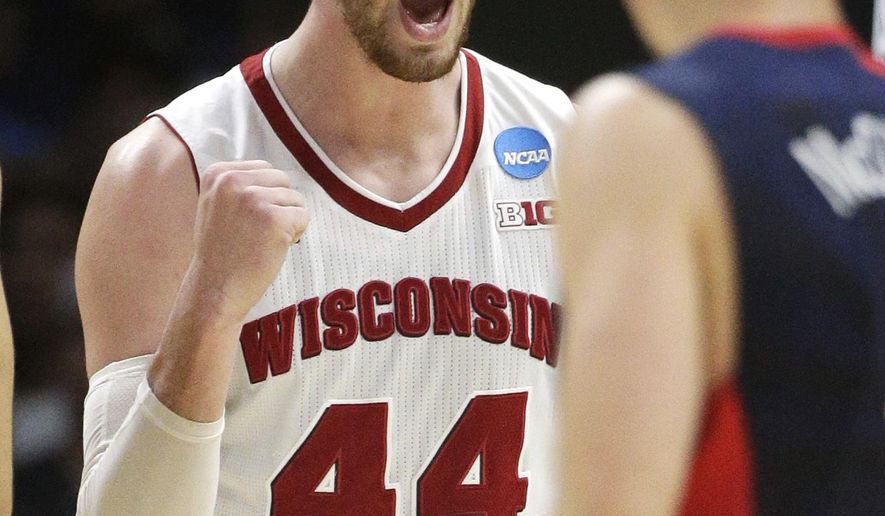 File-This March 28, 2015, file photo shows Wisconsin forward Frank Kaminsky reacting after winning possession of the ball against Arizona during the second half of a college basketball regional final in the NCAA Tournament, in Los Angeles. When Kentucky, with four NBA-quality freshmen on the roster, lost to a senior-laden team from Wisconsin in the semifinals Saturday, it struck a blow for traditionalists who say you can still have it all, a full college career, a chance to play for a title, a wealthy future in the NBA. Player of the Year  Kaminsky and two of his teammates, Sam Dekker and Nigel Hayes, forged opportunities to do all that with the Badgers.  (AP Photo/Jae C. Hong, File)