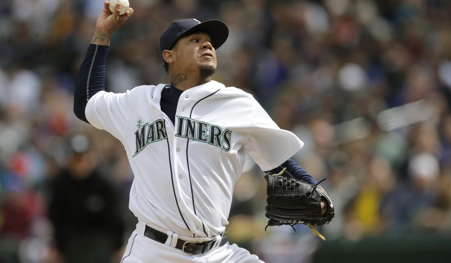 Seattle Mariners starting pitcher Felix Hernandez throws against the Los Angeles Angels in the third inning of an opening day baseball game, Monday, April 6, 2015, in Seattle. (AP Photo/Ted S. Warren)