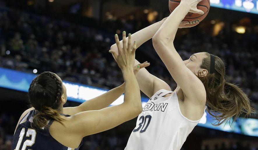Connecticut forward Breanna Stewart (30) shoots over Notre Dame forward Taya Reimer (12) during the first half of the NCAA women's Final Four tournament college basketball championship game, Tuesday, April 7, 2015, in Tampa, Fla. (AP Photo/Brynn Anderson )