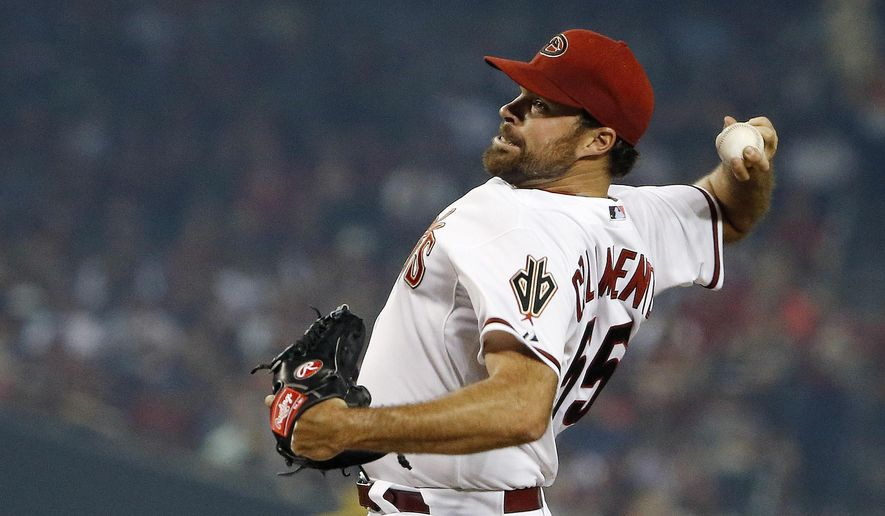 Arizona Diamondbacks' Josh Collmenter throws a pitch against the San Francisco Giants during the first inning of an opening day baseball game Monday, April 6, 2015, in Phoenix. (AP Photo/Ross D. Franklin)