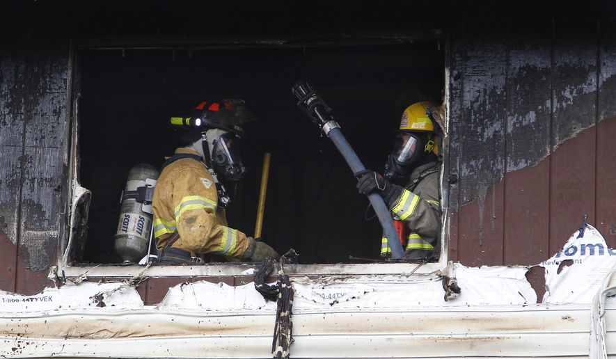 Area firefighters respond to a mutual aid home fire at 326 Bellefontaine St. Monday, April 6, 2015, in Evansdale, Iowa. There were no apparent injuries.(AP Photo/The Courier, Matthew Putney)