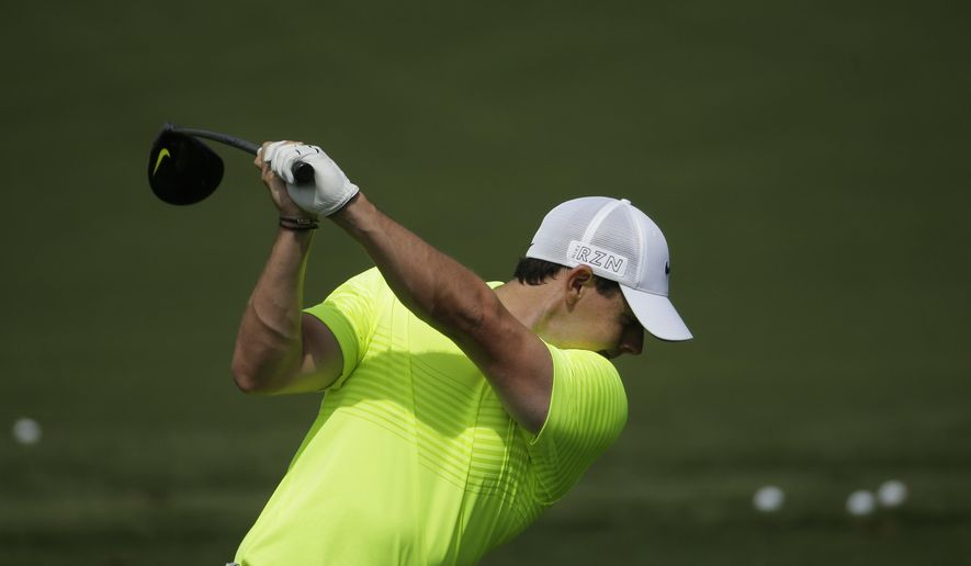 Rory McIlroy, of Northern Ireland, hits on the driving range during a practice round for the Masters golf tournament Tuesday, April 7, 2015, in Augusta, Ga. (AP Photo/Chris Carlson)