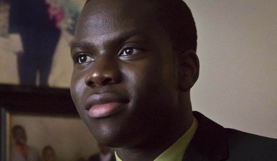 Harold Ekeh, a senior at Elmont Memorial High School, listens during an interview, Tuesday, April 7, 2015, in New York. Ekeh has been accepted to all 13 colleges he applied to, including the eight Ivy League schools. Ekeh, who plans to study medicine, has until May 1 to decide where he'll go.  (AP Photo/Bebeto Matthews)