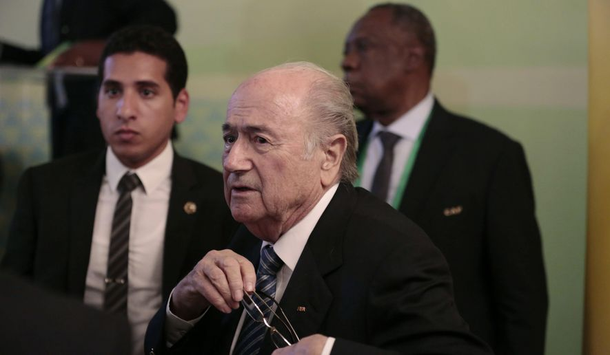 "FIFA President Sepp Blatter, center, and Confederation of African Football President Issa Hayatou, back right, leave a press conference in Cairo, Egypt, Tuesday, April 7, 2015. Every one of Africa's 54 member countries will vote for Sepp Blatter in next month's FIFA presidential election, the continent's soccer boss said on Tuesday, referring to the 79-year-old Swiss as ""dear Sepp "". (AP Photo/Hassan Ammar)"