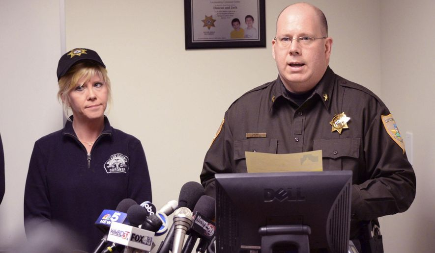 McLean County Sheriff's Department Sheriff Jon Sandage and McLean County Coroner Kathy Davis answer questions concerning a plane crash on Tuesday, April 7, 2015, in Bloomington, Ill.  A small private plane returning from the NCAA college basketball tournament in Indianapolis crashed in a central Illinois field killing all seven people onboard. (AP Photo/The Pantagraph, Steve Smedley)