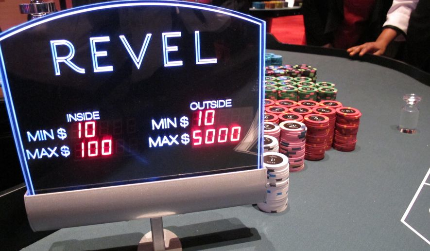 This April 2, 2012 photo shows a table games sign and chips on a table at the Revel casino in Atlantic City, N.J. on the morning it opened. The casino shut down on Sept. 2, 2014, and was sold on Tuesday April 7, 2015 to Florida developer Glenn Straub for $82 million. (AP Photo/Wayne Parry)