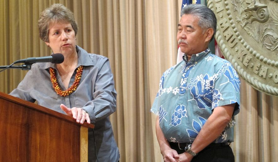 Suzanne Case, left, speaks at a news conference with Hawaii Gov. David Ige, right, Tuesday, April 7, 2015, in Honolulu. Ige nominated Case to lead the Department of Land and Natural Resources after withdrawing his last nominee due to lack of support from the Senate. (AP Photo/By Cathy Bussewitz)