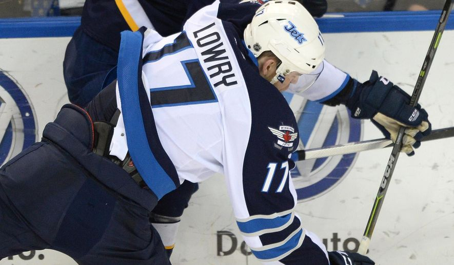 St. Louis Blues' Steve Ott, top, collides with Winnipeg Jets' Adam Lowry (17) during the second period of an NHL hockey game, Tuesday, April 7, 2015, in St. Louis. (AP Photo/Bill Boyce)