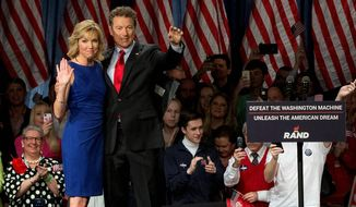 'Message of liberty' Sen. Rand Paul, joined by wife Kelley Ashby, announced his presidential candidacy in Louisville, Kentucky, on Tuesday, becoming the second tea party favorite to enter the Republican race. (Associated Press)  ** FILE **
