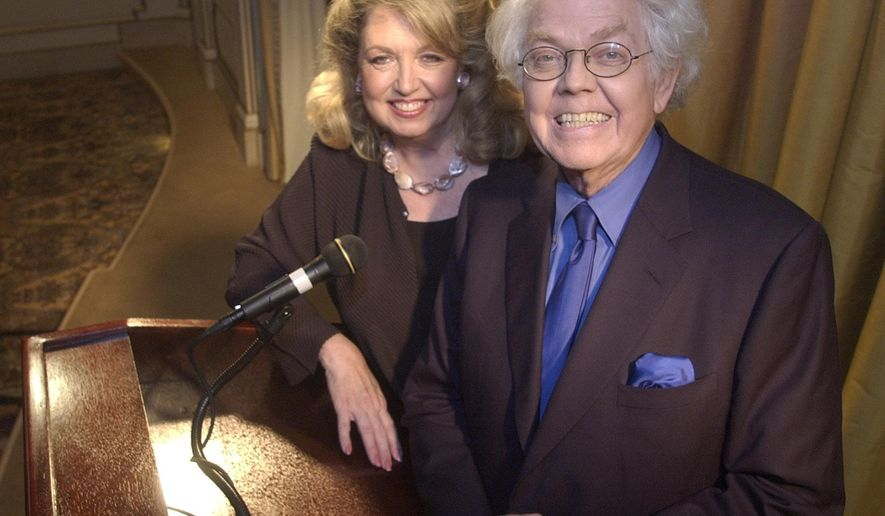 """FILE - In this July 25, 2003 file photo, satirist Stan Freberg, 76, right, and his wife, Hunter, pose for a photo Beverly Hills, Calif. Freberg, the writer and comedian who lampooned American life in """"The United States of America"""" and other landmark comedy albums and was hailed as the father of the funny commercial, has died at age 88.  Freberg's wife, Hunter, says the humorist died Tuesday, April 7, 2015, at the UCLA Medical Center in Santa Monica.  (AP Photo/Matt Sayles, File)"""