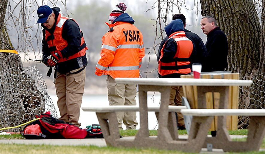 In a Monday, April 6, 2015 photo, the Yankton County Search and Rescue Dive team were on the scene at Riverside Park in Yankton, S.D., in search of a missing 6-year-old boy who is believed to have fallen in the Missouri River Sunday evening. Police tell KELO-TV that the rescue effort is now a mission to recover the body of Lincoln Hilt, of Hurley. (AP Photo/Yankton Press & Dakotan, Shauna Marlette)