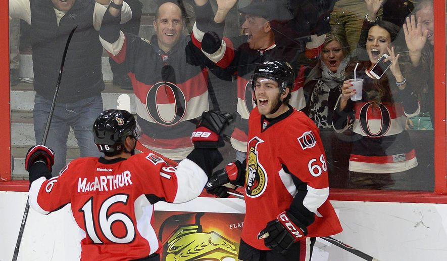 Ottawa Senators' Mike Hoffman (68) celebrateswith  teammate Clarke MacArthur (16) after Hoffman's game-tying goal against the Pittsburgh Penguins during the third period of an NHL hockey game Tuesday, April 7, 2015, in Ottawa, Ontario. (AP Photo/The Canadian Press, Justin Tang)