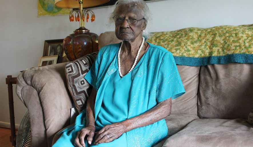 FILE- In this May 22, 2014 file photo, Jeralean Talley poses for a photo in Inkster, Mich. The 115-year-old Detroit-area woman, born on May 23, 1899, tops a list maintained by the Los Angeles-based Gerontology Research Group which tracks the world's longest-living people. Gertrude Weaver, a 116-year-old Arkansas woman who was the oldest documented person for a few days, died on Monday, April 6, 2015. (AP Photo/Detroit Free Press, Elisha Anderson) DETROIT NEWS OUT;  NO SALES