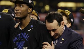 Duke head coach Mike Krzyzewski, right, celebrates with Justise Winslow after their 68-63 victory over Wisconsin in the NCAA Final Four college basketball tournament championship game Monday, April 6, 2015, in Indianapolis.(AP Photo/David J. Phillip)