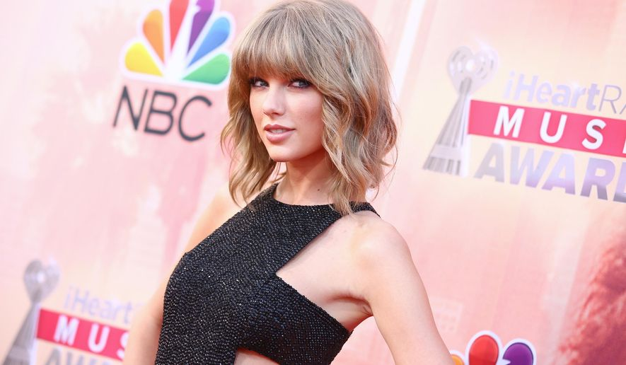 "FILE - In this March 29, 2015 file photo, Taylor Swift arrives at the iHeartRadio Music Awards at The Shrine Auditorium in Los Angeles.  Swift's mega-selling ""1989"" album earned her a nomination for top artist at the 2015 Billboard Music Awards. Swift's competition includes Sam Smith, Ariana Grande, One Direction and Katy Perry. Ludacris and Pete Wentz announced some of the nominees Tuesday, April 7, 2015 on ""Good Morning America.""(Photo by John Salangsang/Invision/AP)"