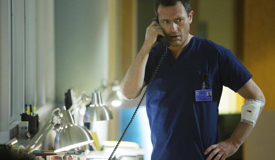 """In this image released by USA Network, Jason O'Mara appears in a scene from """"Complications,"""" a new series about a suburban doctor who intervenes in a drive-by shooting, premiering June 18 at 9 p.m. ET on USA. (Photo by: Daniel McFadden/USA Network)"""
