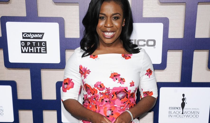 """FILE - In this Feb. 19, 2015, file photo, Uzo Aduba arrives at the 8th Annual Essence Black Women In Hollywood Luncheon held at the Beverly Wilshire Hotel in Beverly Hills, Calif. Aduba, the lifelong athlete who plays Crazy Eyes on """"Orange is the New Black,"""" is preparing to run a marathon to raise money for cancer research. (Photo by Richard Shotwell/Invision/AP, File)"""