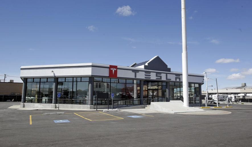 This April 1, 2015, photo shows the Tesla Motors new showroom in Salt Lake City. Tesla Motors has built a new showroom to sell its sleek electric cars, but no one can buy, drive or discuss prices there after Utah officials ruled it violates state laws about car makers owning dealerships. (AP Photo/Rick Bowmer)