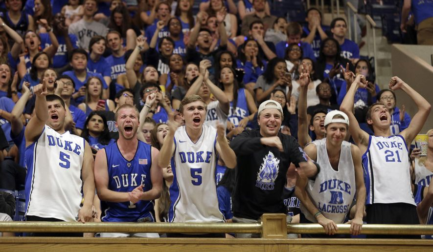 Duke students cheer while gathered in Cameron Indoor Stadium in Durham, N.C., to watch a broadcast of the NCAA Final Four college basketball game between Duke and Wisconsin Monday, April 6, 2015. (AP Photo/Gerry Broome)