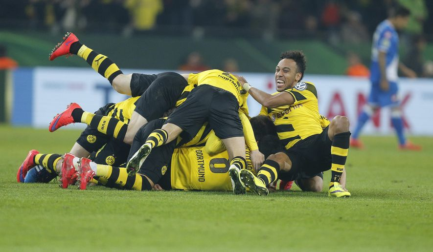 Dortmund players celebrate after scoring in extra time during the German soccer cup (DFB Pokal) quarterfinal match between BvB Borussia Dortmund and TSG 1899 Hoffenheim Tuesday, April 7, 2015 in Dortmund, Germany. (AP Photo/Frank Augstein)