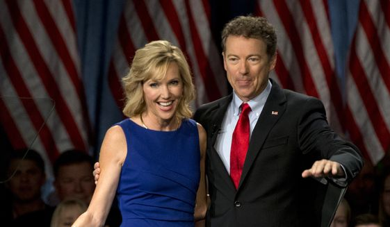 Sen. Rand Paul, R-Ky., joined by his wife, Kelley Ashby, arrives to announce the start of his presidential campaign, Tuesday, April 7, 2015, at the Galt House Hotel in Louisville, Ky. (AP Photo/Carolyn Kaster) ** FILE **