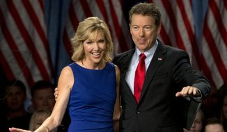 Sen. Rand Paul, R-Ky., joined by his wife, Kelley Ashby, arrives to announce the start of his presidential campaign, Tuesday, April 7, 2015, at the Galt House Hotel in Louisville, Ky. (AP Photo/Carolyn Kaster)