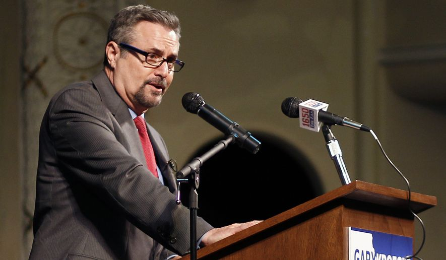 Gary Kroeger officially kicks off his bid for the Democratic nomination for Iowa's 1st congressional District at the Oster Regent Theater, Monday, April 6, 2015, in Cedar Falls, Iowa. Kroeger, a former Saturday Night Live cast member, says he wants to focus on progressive policies, such as investing in education and protecting the environment. (AP Photo/Waterloo Courier, Matthew Putney)