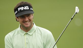 Bubba Watson gets ready to hit on the driving range during a practice round for the Masters golf tournament Tuesday, April 7, 2015, in Augusta, Ga. (AP Photo/Matt Slocum)