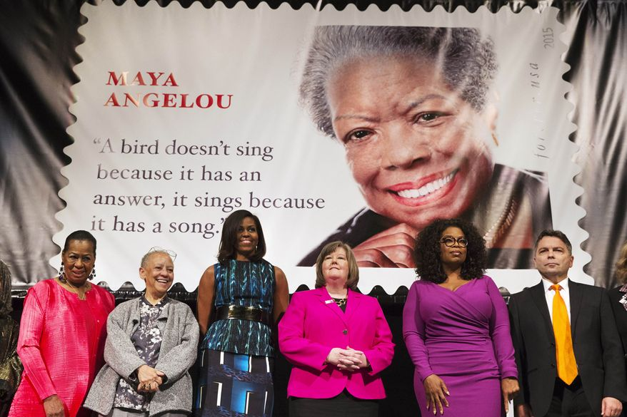 First lady Michelle Obama participates in the unveiling of the Maya Angelou Forever Stamp, Tuesday, April 7, 2015, at the Warner Theater in Washington. From left are, Eleanor Traylor, English Professor at Howard University; poet Nikki Giovanni; Mrs. Obama; Postmaster General Megan Brennan; Oprah Winfrey, and artist Ross Rossin. (AP Photo/Jacquelyn Martin)