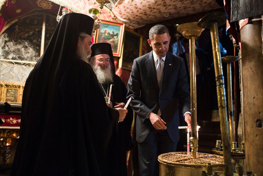 President Barack Obama lights candles as he tours the crypt containing the birthplace of Jesus during his visit to the Church of the Nativity in Bethlehem, the West Bank, March 22, 2013. (Official White House Photo by Pete Souza)