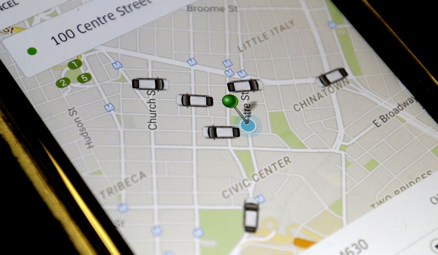 In this Wednesday, March 18, 2015, file photo, the Uber app displays cars available to make a pickup in downtown Manhattan on a smart phone, in New York. A new report by expense management system provider Certify shows that 47 percent of the ground transportation rides by its users in March were through Uber. (AP Photo/Mary Altaffer, File)