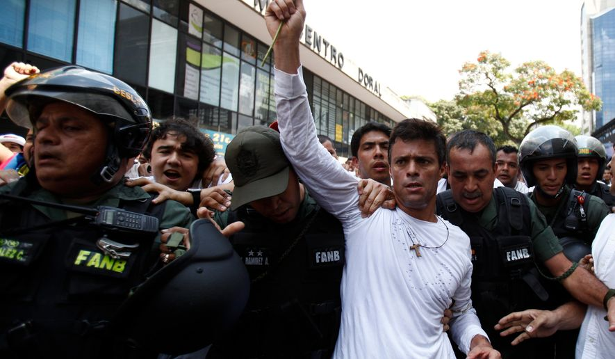 In this Feb. 18, 2014, file photo, opposition leader Leopoldo Lopez, dressed in white and holding up a flower stem, is taken into custody by Bolivarian National Guards, in Caracas, Venezuela. From Mexico to Brazil, leaders in Latin America have been largely silent in the face of a growing crackdown on dissent in Venezuela and are unlikely to speak out against their neighbor at the upcoming Summit of the Americas on April 10, 2015, in Panama. (AP Photo/Alejandro Cegarra, FIle)