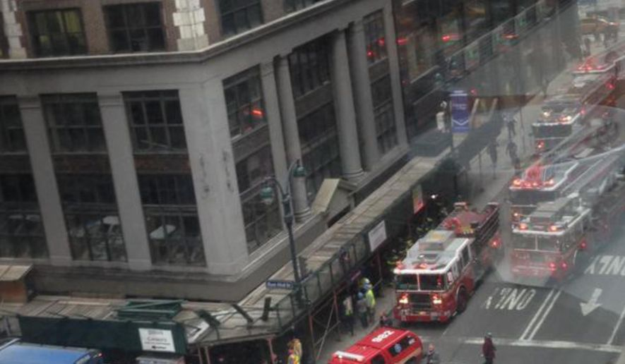 In this photo provided by Kaitlyn Ford, emergency personnel work the scene where authorities said four construction workers suffered serious injuries in a partial wall collapse inside a commercial building near Grand Central Terminal, in New York. The cause of the partial collapse is under investigation. No other details were immediately available. (AP Photo/Kaitlyn Ford)