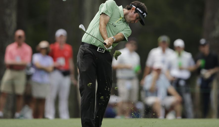 Bubba Watson hits on the 14th hole during a practice round for the Masters golf tournament Tuesday, April 7, 2015, in Augusta, Ga. (AP Photo/Matt Slocum)