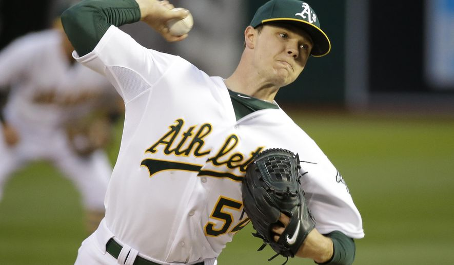 Oakland Athletics starting pitcher Sonny Gray throws against the Texas Rangers in the first inning of their opening day baseball game Monday, April 6, 2015, in Oakland, Calif. (AP Photo/Eric Risberg)