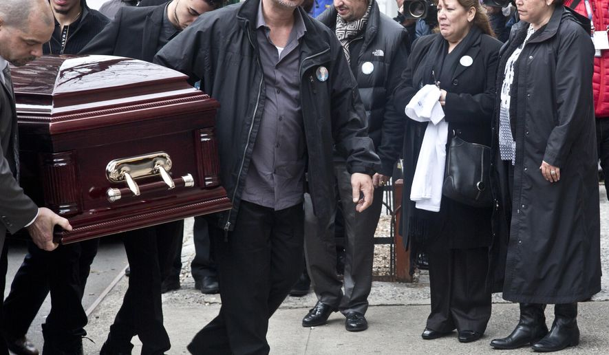 Family members and friends observe as pallbearers carry the casket for Nicholas Figuero, one of two men who died in the East Village explosion and building collapse, for a funeral service at the Church of the Holy Name of Jesus, Tuesday, April 7, 2015, in New York. (AP Photo/Bebeto Matthews)