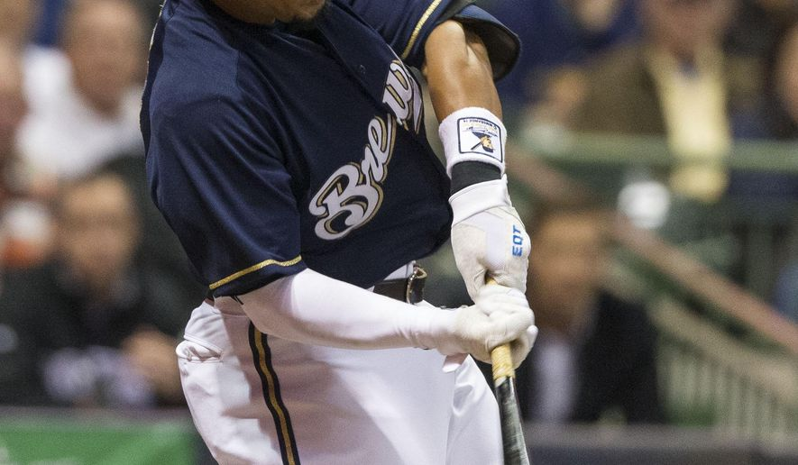 Milwaukee Brewers' Carlos Gomez connects for a double off Colorado Rockies' Jordan Lyles during the fifth inning of a baseball game Tuesday, April 7, 2015, in Milwaukee.  (AP Photo/Tom Lynn)