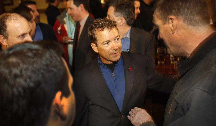 Presidential hopeful, U.S. Sen. Rand Paul, R-Ky., center, meets with supporters at Murpheys Taproom, Tuesday, April 7, 2015, in Manchester, N.H. (AP Photo/Jim Cole)
