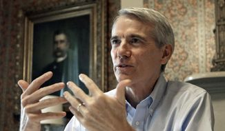 In this Monday, Oct. 13, 2014, file photo, Sen. Rob Portman, R-Ohio, speaks during an interview in Lebanon, Ohio. (AP Photo/Al Behrman, File)