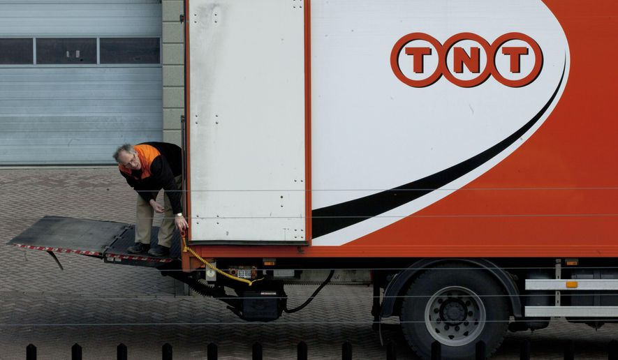 FILE - In this Feb. 21, 2012 file photo, a TNT employee operates a delivery truck in Hoofddorp, near Amsterdam, Netherlands.  American package delivery service FedEx said Tuesday, April 7, 2015 it plans to take over its Dutch rival TNT Express, one of Europe's largest delivery companies, for 4.4 billion euros ($4.8 billion), in a move FedEx says will strengthen its business around the world. (AP Photo/Peter Dejong, File)