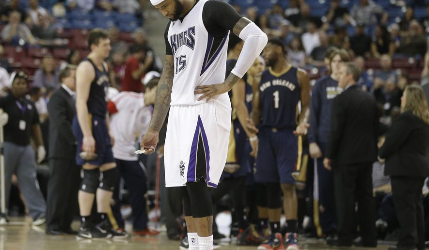 Sacramento Kings center DeMarcus Cousins walks the court during a timeout in the final moments of the Kings' 101-95 loss to the News Orleans Pelicans in an NBA basketball game in Sacramento, Calif., Friday, April 3, 2015. (AP Photo/Rich Pedroncelli)