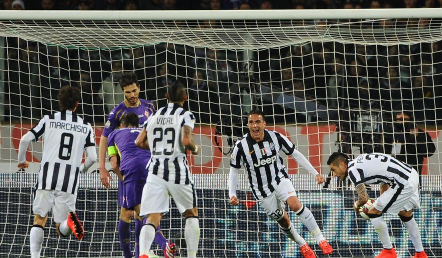 Juventus' Alessandro Matri, second from right, celebrates after scoring during an Italian Cup semifinal return soccer match between Juventus and Fiorentina,  at the Artemio Franchi stadium in Florence, Italy, April 7, 2015. (AP Photo/Maurizio Degl' Innocenti) ITALY OUT