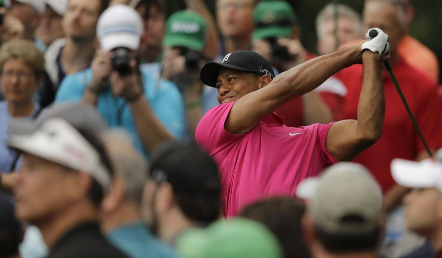 Tiger Woods tees off on the ninth hole during a practice round for the Masters golf tournament Tuesday, April 7, 2015, in Augusta, Ga. (AP Photo/Matt Slocum)