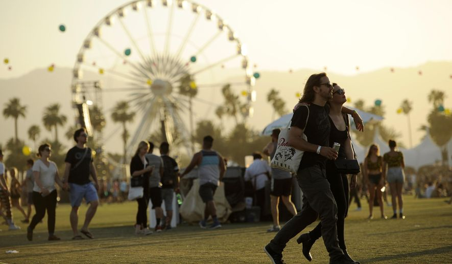 FILE - In this April 13, 2014 file photo, Coachella festivalgoers walk through the Empire Polo Field on the third day of the 2014 Coachella Music and Arts Festival in Indio, Calif. SiriusXM will live broadcast some of the performances from the Coachella Valley Music and Arts Festival for the first time. The satellite radio service announced Tuesday, April 7, 2015, it would broadcast performances from Jack White, Alabama Shakes and others when the festival kicks off Friday. (Photo by Chris Pizzello/Invision/AP, File)