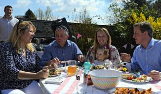 British Prime Minister David Cameron has become the subject of online ridicule after he was caught eating a hot dog with a knife and fork while attempting to connect with ordinary voters at a barbecue. (Twitter/David Cameron)