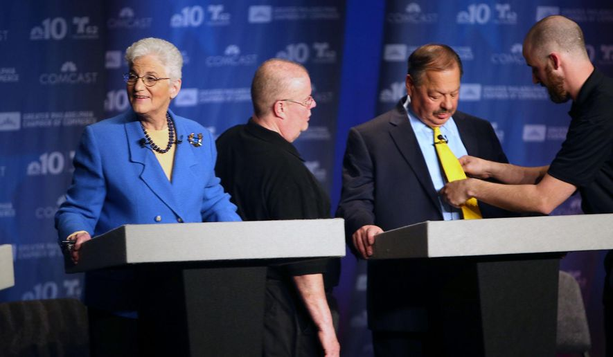Philadelphia mayoral candidates, Lynne Abraham, left, and Nelson Diaz, second from right, prepare before a debate at the Kimmel Center in Philadelphia, Tuesday, April 7, 2015. Abraham, whose spokesman said she fainted during the debate, is one of six Democrats running to replace two-term Mayor Michael Nutter. (AP Photo/The Philadelphia Inquirer, Stephanie Aaronson)  PHIX OUT; TV OUT; MAGS OUT; NEWARK OUT