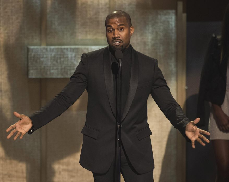 FILE - In this Jan. 24, 2015, file photo, BET Honoree Kanye West accepts the Visonary Award at the BET Honors 2015 at Warner Theater in Washington. West on Tuesday, April 7, 2015, settled a lawsuit filed by a paparazzo who the rapper attacked outside a Los Angeles International Airport terminal in 2013. Daniel Ramos' attorney Gloria Allred wrote in a statement that  the suit was settled in part after West apologized to her client and the pair shook hands.  (Photo by Kevin Wolf/Invision/AP, File)